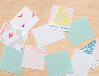 swatches of quilting fabrics laid out on table