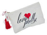 Philly LOVE printed canvas pouch with tassel. Opposite side has pretzel, bell and LOVE.