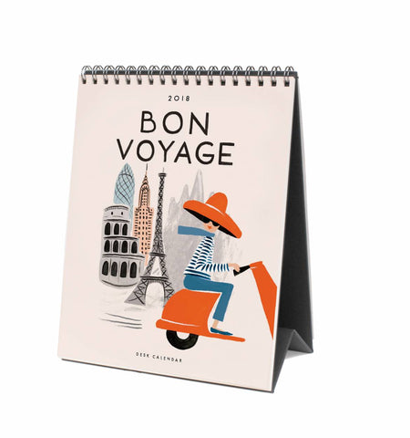 From Rifle Paper featuring 12 illustrated cities from around the world. 2018 Bon Voyage Desk Calendar highlights destinations such as New York, London, and Tokyo, among others.