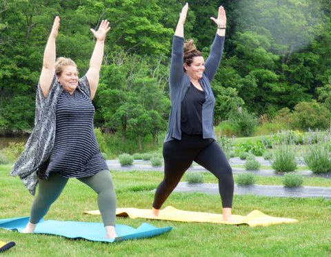 two ladies doing yoga in the lavender link for ordering