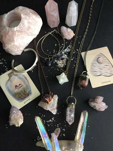 Portland Local Morgaine Faye Rose Quartz Crystal Point Necklace with Lapis Lazuli, Bones N Things False Rose Quartz Necklace, Crystal Vision Gems' Rose Quartz and Amethyst Copper Necklace, NUCULT Acension Stone Opalite Necklace, Pigeon Heart Earrings Altar PDX Gothic Jewelry