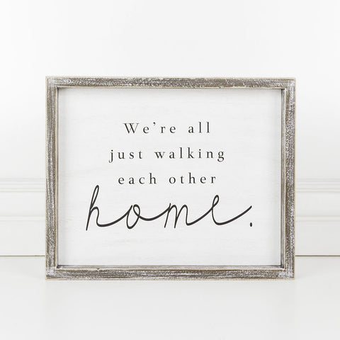 """We're All Just Walking Each Other Home"" Framed Sign"