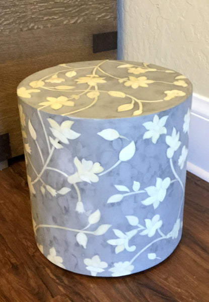 Round resin stool with bone inlay