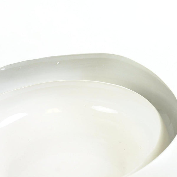 Low and round, white earthenware bowl