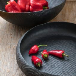 Black crosshatched aluminum serving bowls and trays.