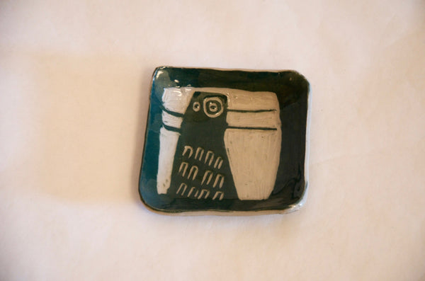 Artisanal handmade ceramic square dish with bird motif in green color.