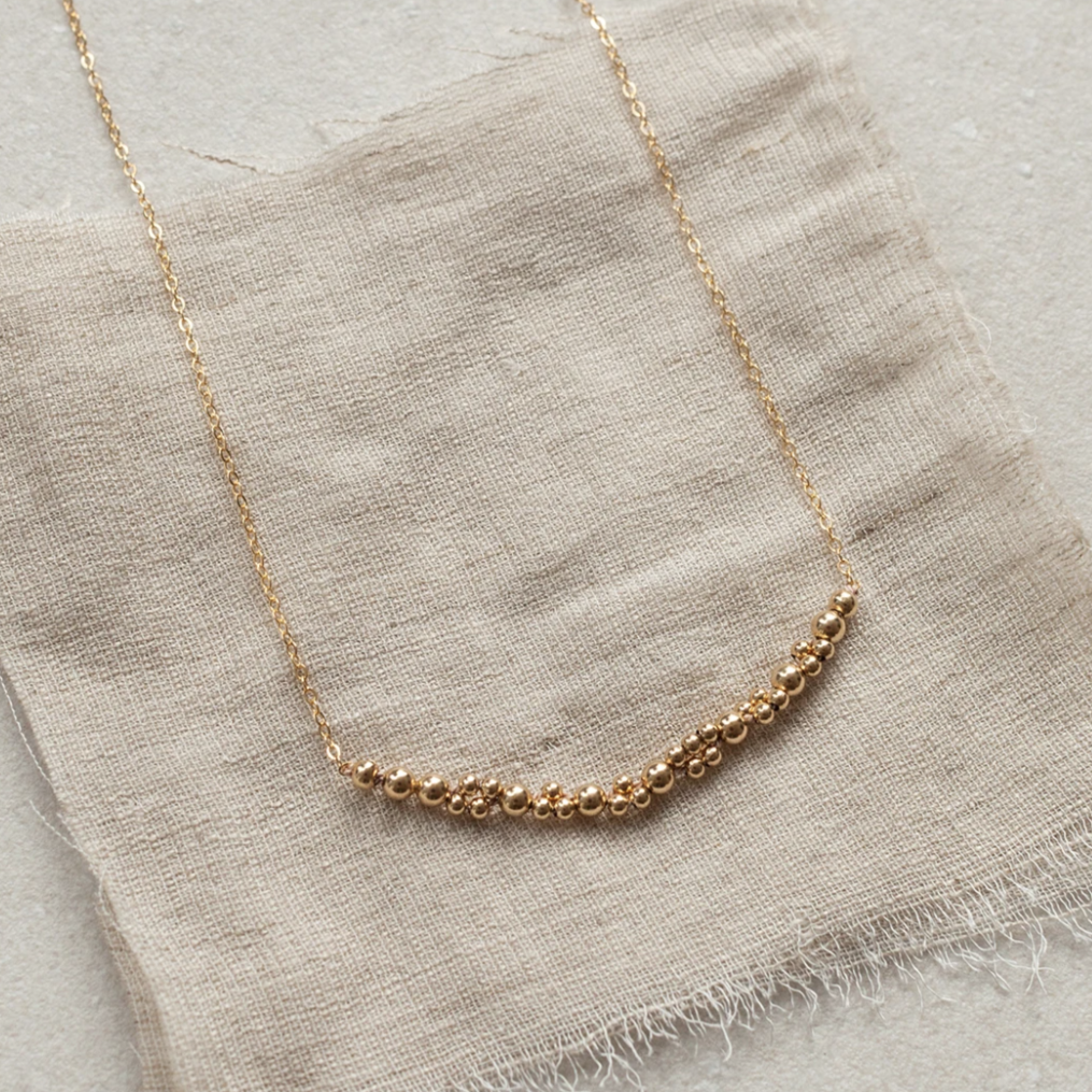 Columba adds a bold touch of elegance on its own or to layer up with other necklaces. An alternative design to popular bar necklaces, it features a segment of Abacus Row's signature bead work captured on a simple chain.