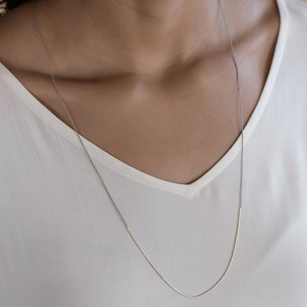 The Dorado is an elegant silk cord necklace for the ultra-minimalist. The single adjustable length strand adds a subtle touch of elegance, and for a bolder look layer up with multiple strands or with other necklaces.