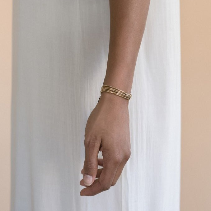 The Gobi is a convertible necklace to wrap bracelet made with 24k gold-plated Japanese glass beads and subtly accented with 14k gold-filled rounds.