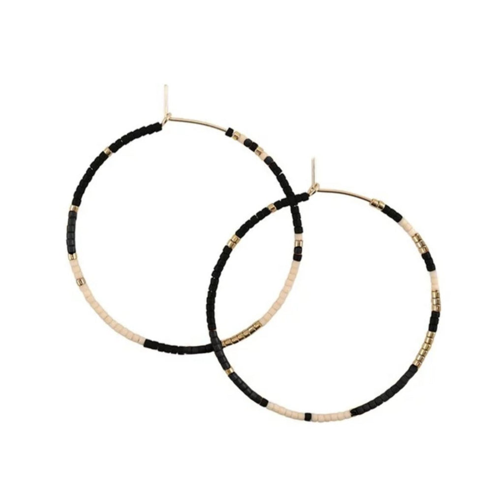 With Abacus Row's Tanami Hoops, designer Christina Trac plays with fixed and open pattern designs. Each earring hoop is hand hammered from 14k gold-filled wire and beaded by hand. These large hoops are whisper light for everyday adornment. Polar