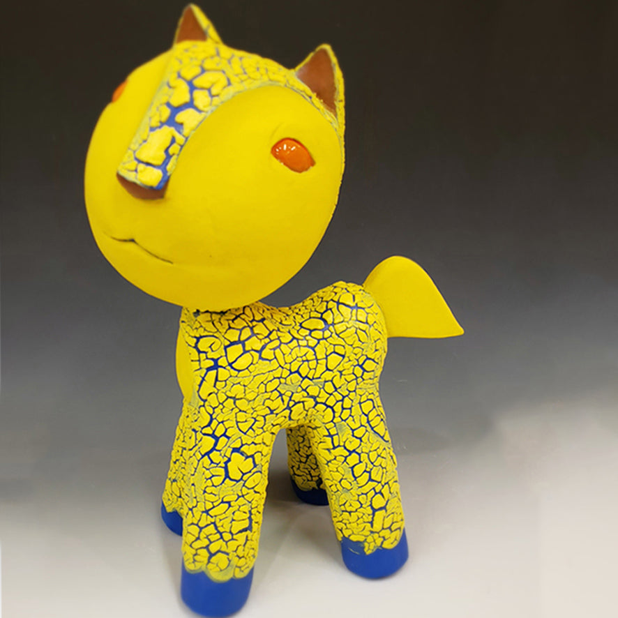 Crystal Cat is part of a new menagerie of ceramic animal sculptures that have landed. Side view.
