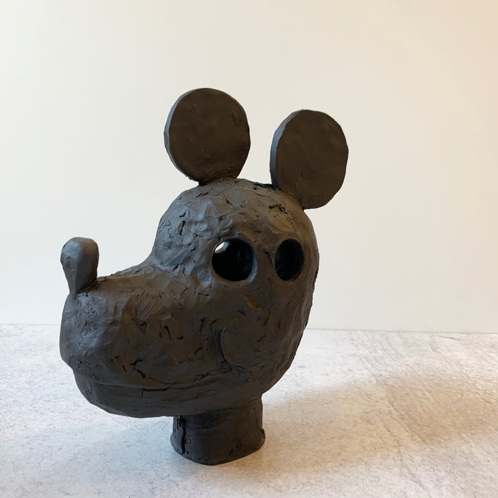 Mickey is a supreme example of Austyn Taylor's blending of animist history with pop culture, sculpted in a very black, ebony like finish using Aardvark Clay's Cassius Basaltic. Front angle view