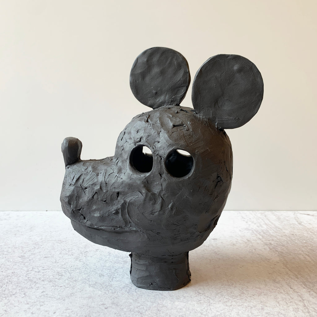 Mickey is a supreme example of Austyn Taylor's blending of animist history with pop culture, sculpted in a very black, ebony like finish using Aardvark Clay's Cassius Basaltic. Front view