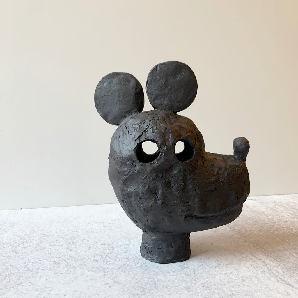 Mickey is a supreme example of Austyn Taylor's blending of animist history with pop culture, sculpted in a very black, ebony like finish using Aardvark Clay's Cassius Basaltic. Side view