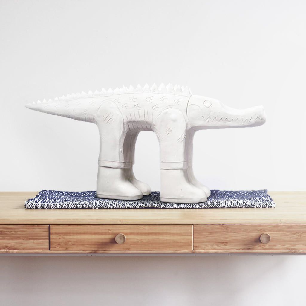 Austyn Taylor Space Jam Porcelain Sculpture Features Unglazed Body and Glazed Boots and Eyes