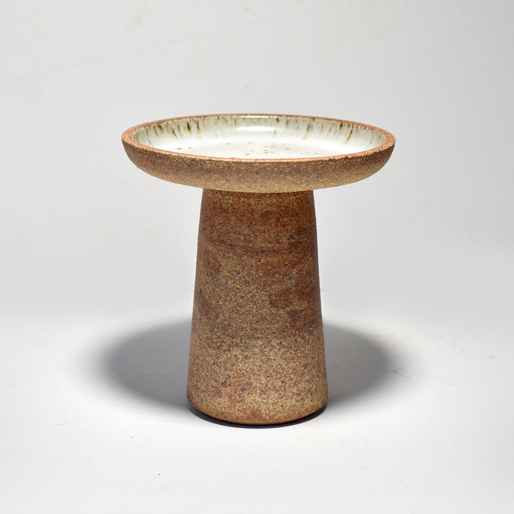 Ceramic Candle Stands by Bob Dinetz are made on the potter's wheel and assembled in almond-colored stoneware from two individually-thrown pieces
