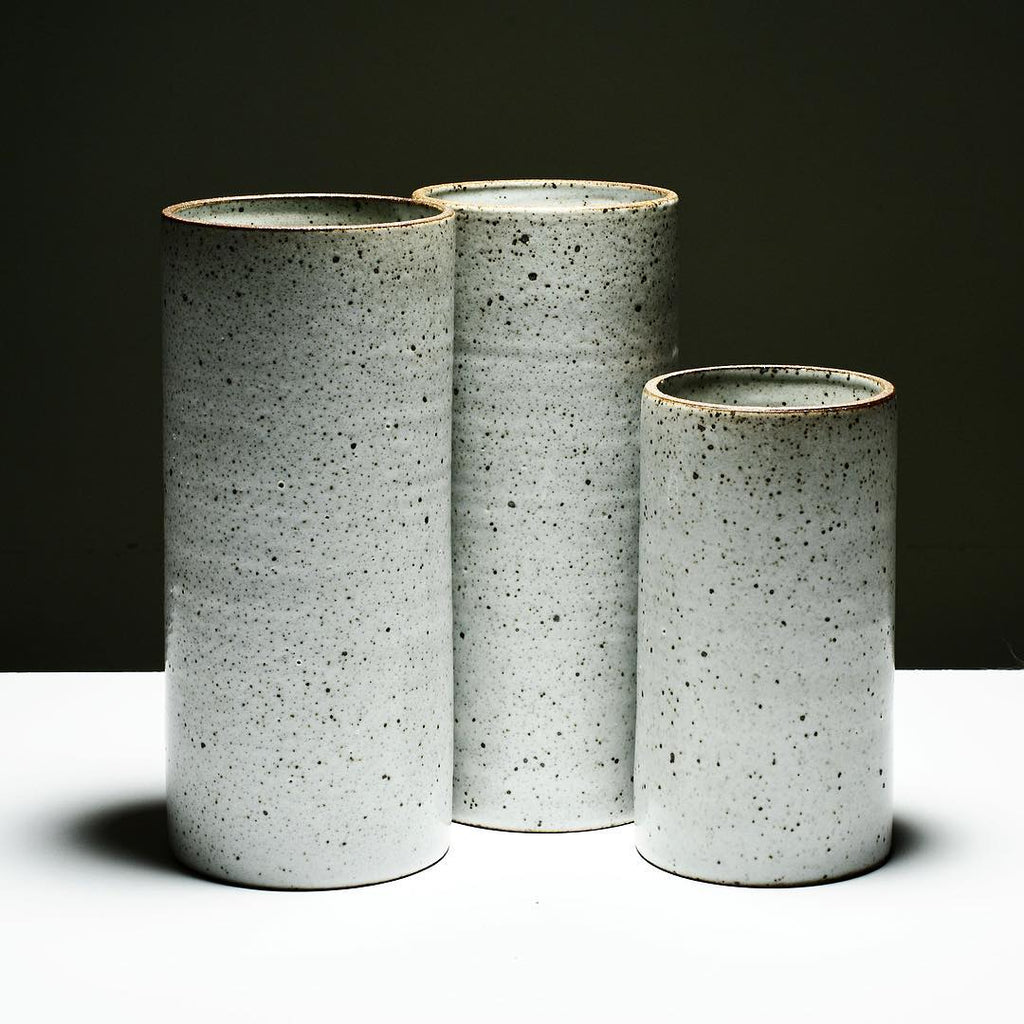 This minimalist yet bold container vase displays flower bouquets in a modern vessel or makes beautiful storage for kitchen utensils. The Birch White glaze has speckles that are a reaction in the kiln from the iron in the clay.