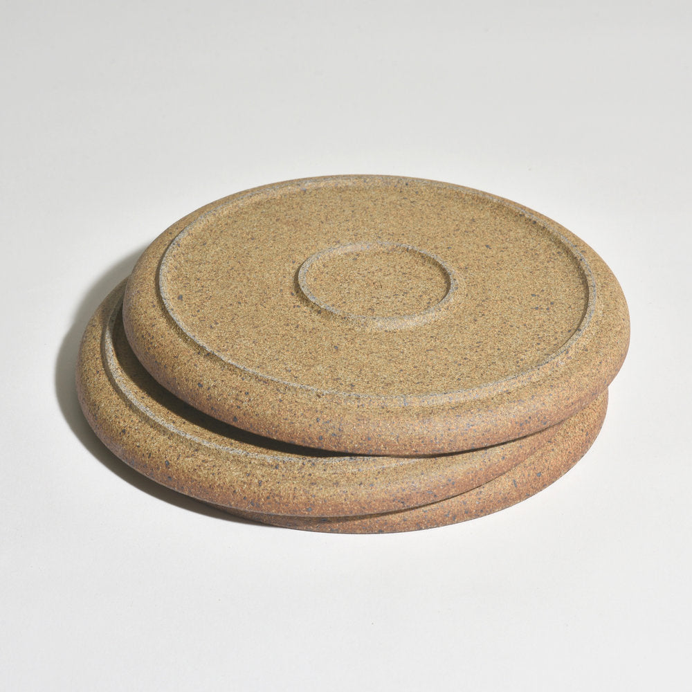 These plates are wheel-thrown and glazed in Birch White while the unglazed exterior, or underside, has a wonderful roasted almond color providing a beautiful contrast to the glazed top surface. Iron in the clay produces the speckles in the surface—the amount varies with each plate. Bottom shown.