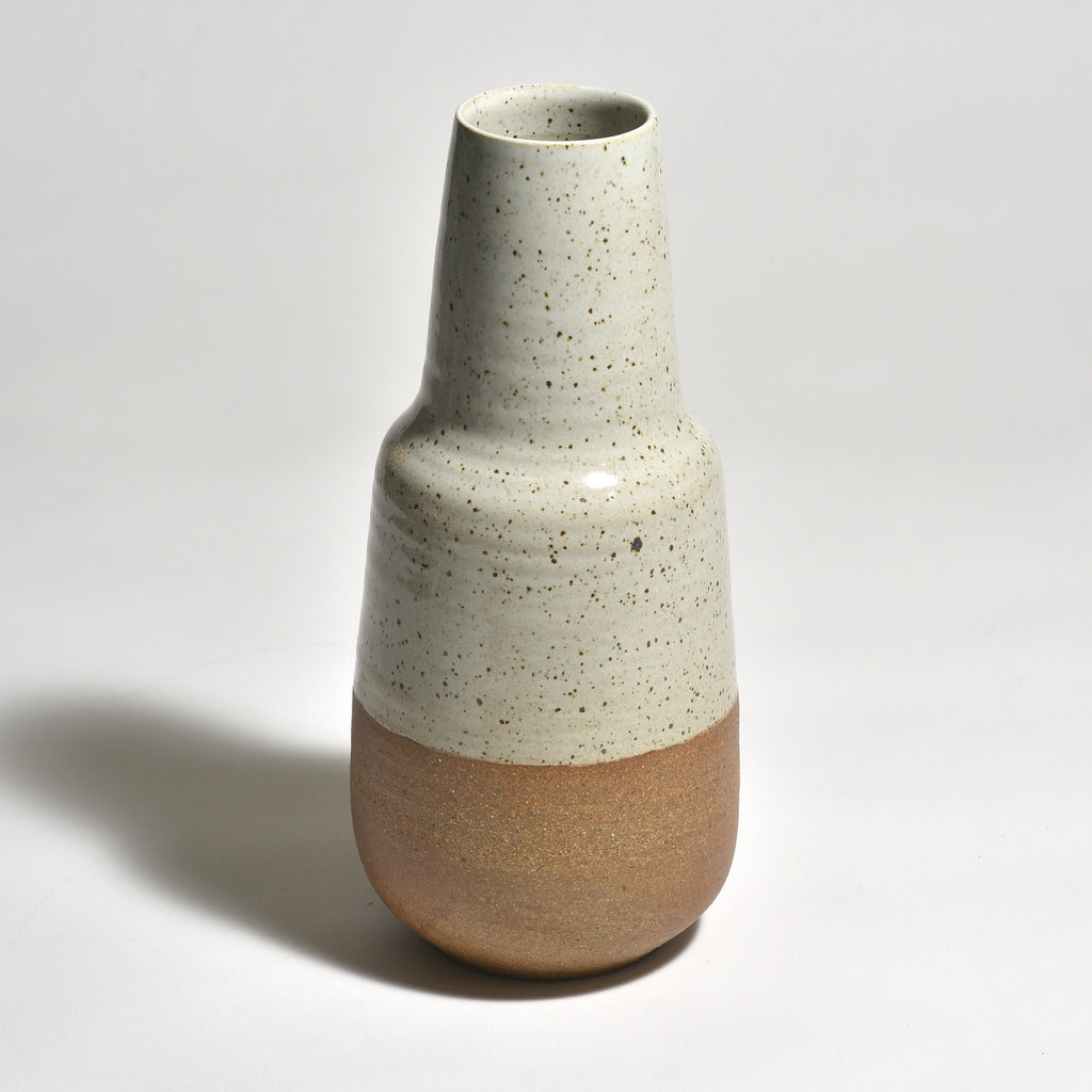 The Step Vase is an elegant vessel for a flower bouquet, tree branch or decorative item on its own. We also love using it to serve Saké. We love the naked clay at the base.