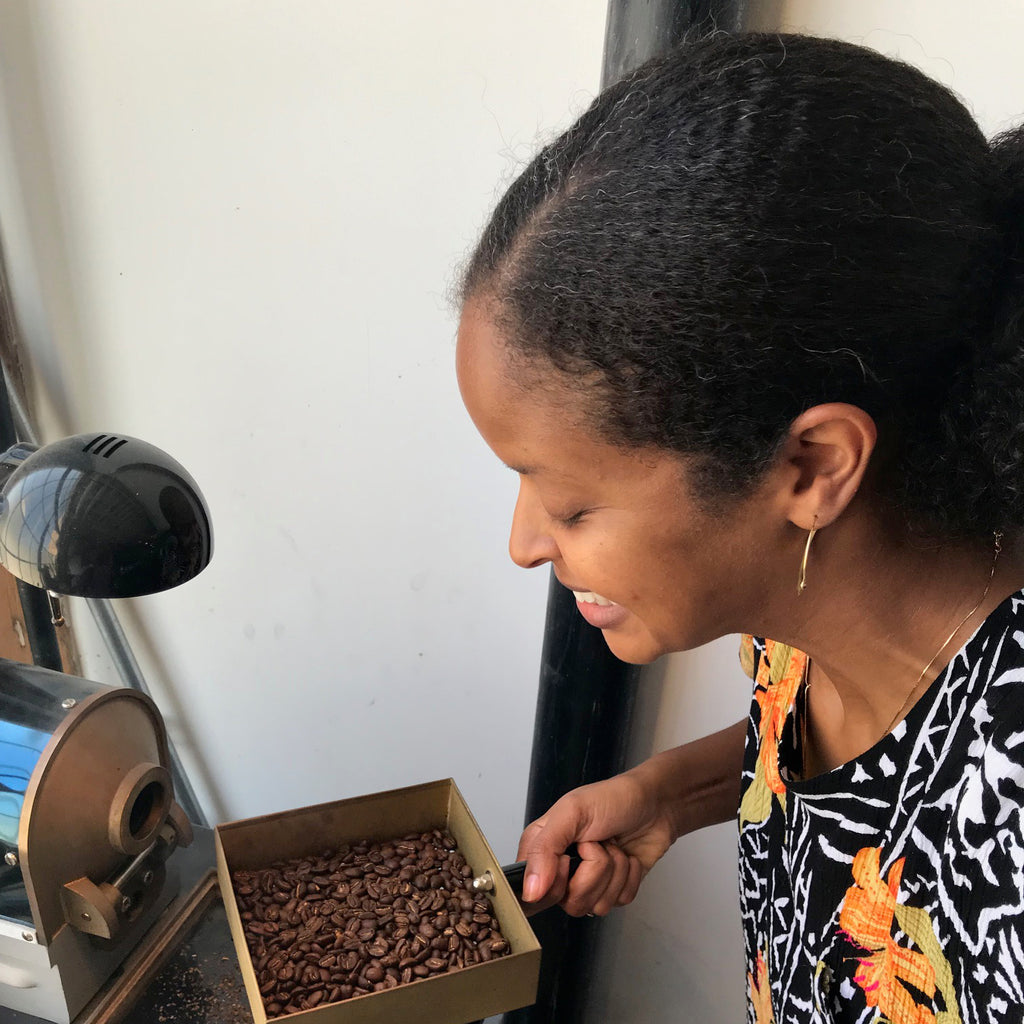 Sabreen Naimah one of the founders of Cute Coffee, testing roasted beans.