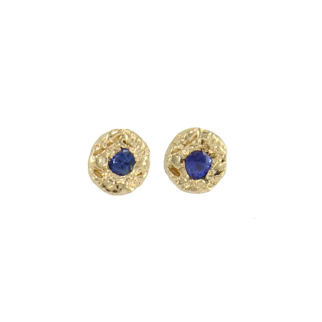 An every day tiny sapphire in 14k gold textured round setting. Danielle takes her signature woven technique to carved wax and cast in precious metal. It's the texture that really makes these beauties stand out.