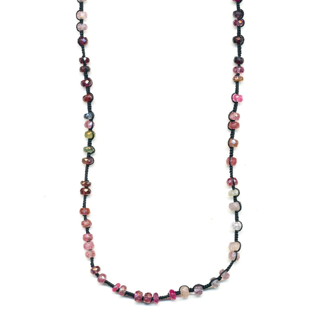 The stunning color palette on this single strand spinel by Danielle Welmond is a perfect layering necklace to add a bright pop of color. Danielle's signature woven technique in between the gem beads is featured on black silk cord.