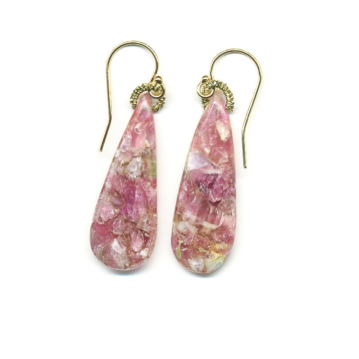 These drop earrings of raw pink tourmaline add beautiful elegance to any outfit. Danielle features her signature precious metal woven technique inspired by the lace making she observed in Italy and France.