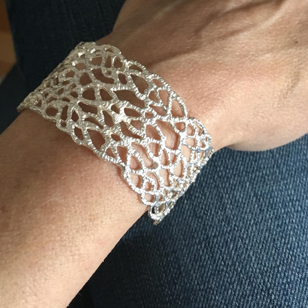 Lacey inspiration, carved in wax, cast in sterling silver. Danielle Welmond takes her signature woven technique this stunning cuff that is both feminine and bold.