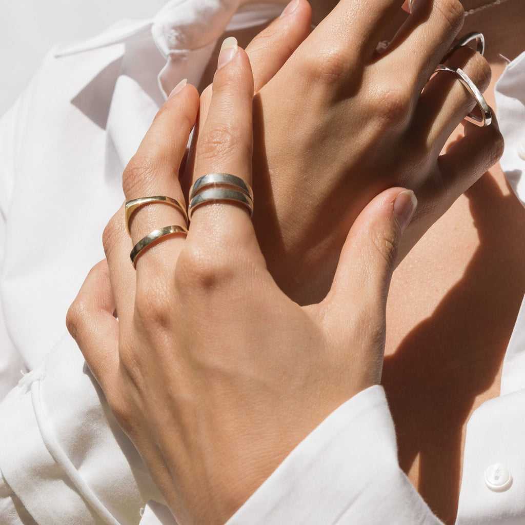 Ende Collective Mini V ring is petite on its own and stunning stacked together. Shown on model with other Ende Collective rings.