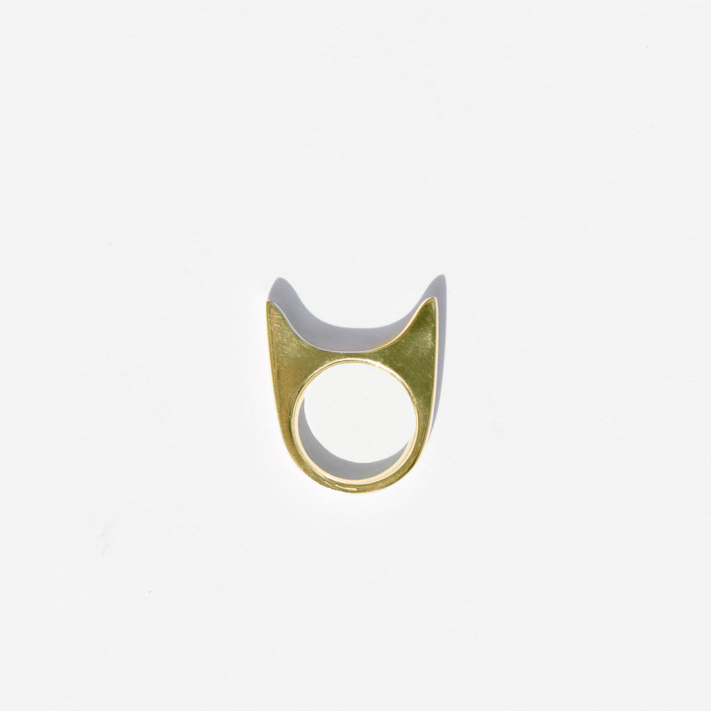 This sly kitten of a ring by Ende Collective is brilliantly designed for a stealthy fit on your ring, middle, or index finger.