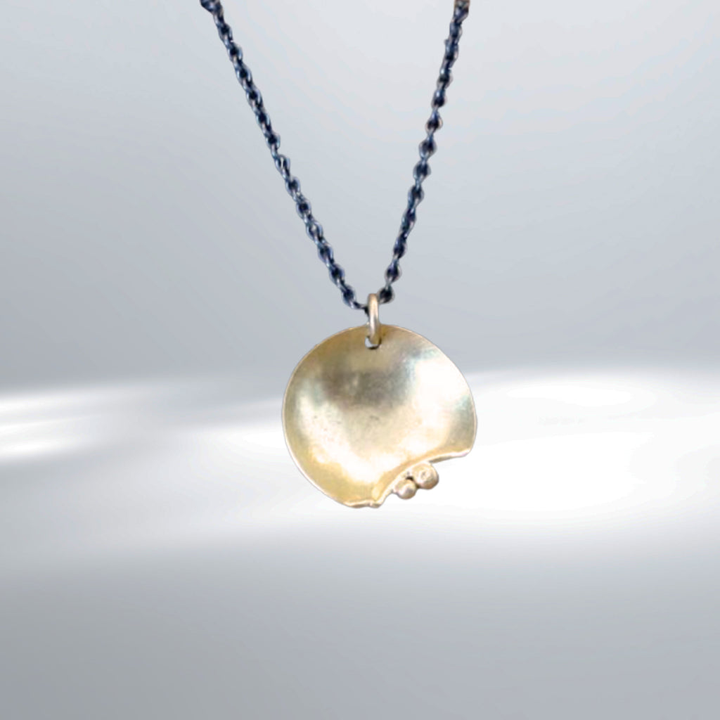 "The Harvest Moon signals the arrival of fall but this necklace can be worn any time of year. So ""go out and feel the night"" with this beautiful handcrafted pendant in 14K yellow gold by Esther Metals."