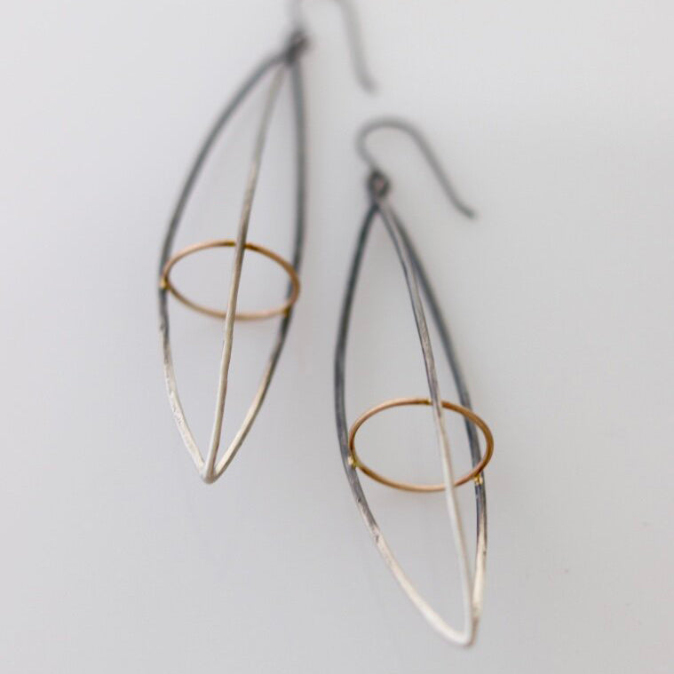 These dramatic earrings hold the Earth within the atmosphere or your inner thoughts among the cosmos. We love how the gold details pop in contrast to the oxidized silver. This version is extra long.