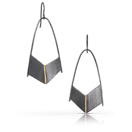 Esther fabricated these earrings to inspire the wearer to feel strength and protection. Their shield-like shape is made using oxidized sterling silver with a 14K yellow gold center seam.