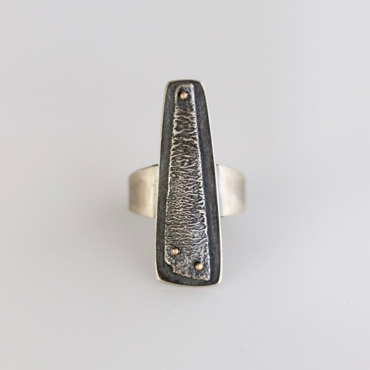 Wear Esther Metals warrior ring as a reminder and badge of honor of the strength you hold, for showing up and standing tall. Hand fabricated. One of a kind. Reticulated and oxidized sterling silver riveted with 14k yellow gold. Size 7.75