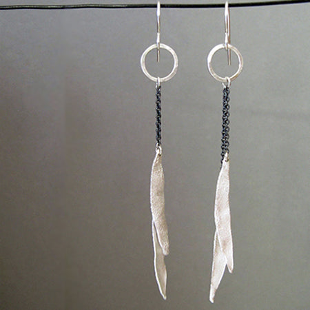 Esther Metals Feathery Earrings will be your go-to earrings with their glistening silver handcrafted feathery wings.