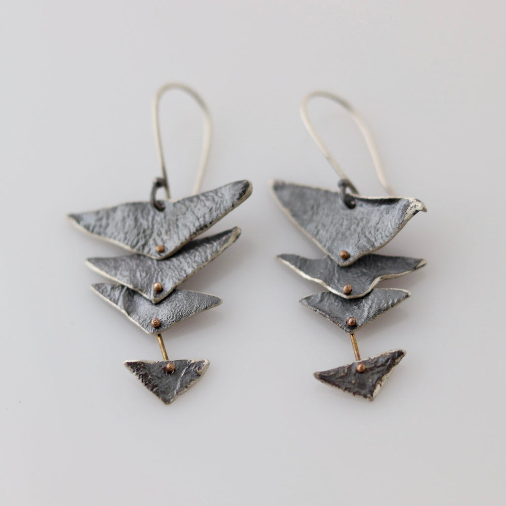 Hand fabricated Precious Arrow earrings. One of a kind. Kinetic reticulated parts attached with hand formed 14k rivets. Reclaimed sterling silver and 14k yellow gold  reticulated texture and oxidized patina.