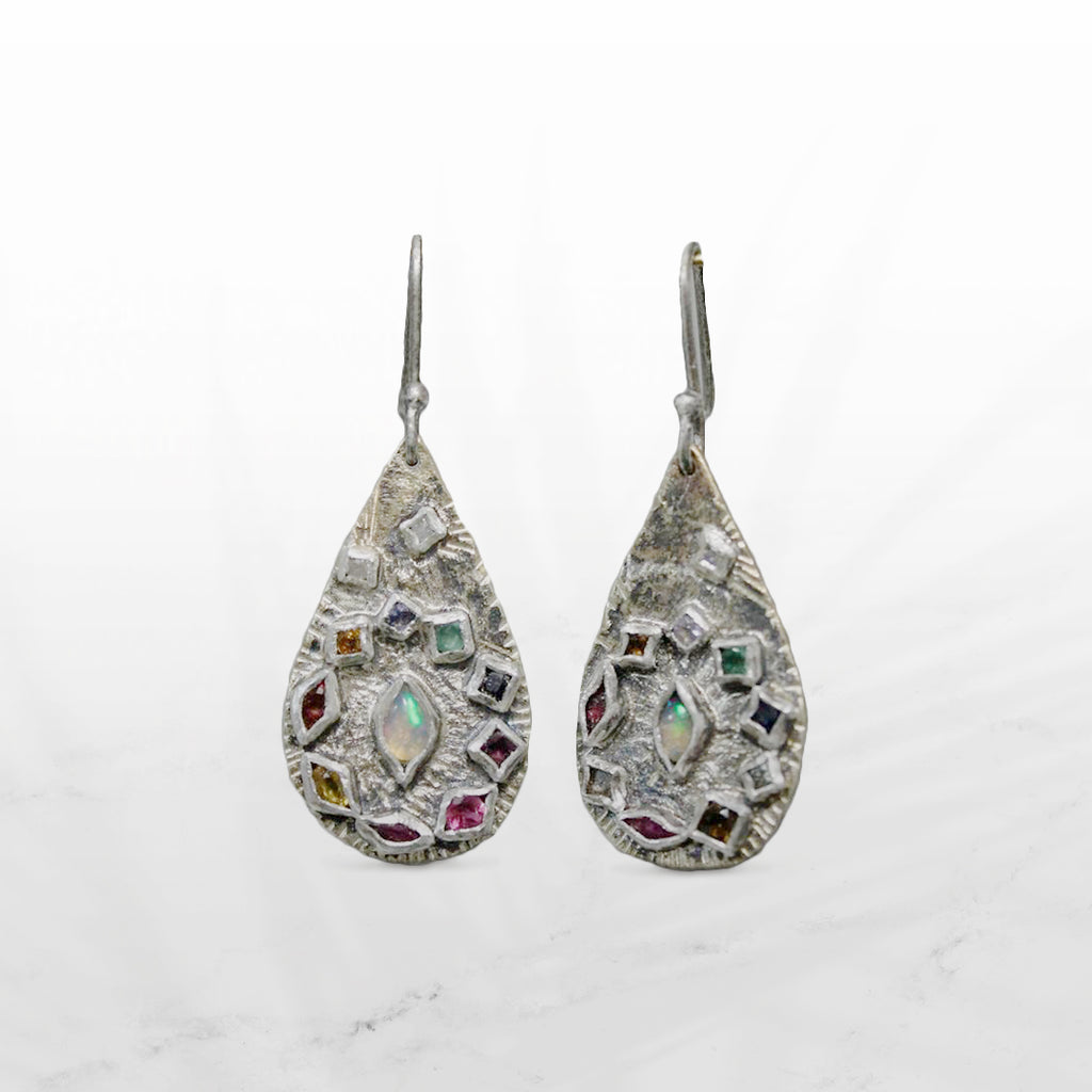 These stunning earrings by Franny E are generously embellished with natural ethically sourced gemstones. Elizabeth works her pieces with tools that have sentimental meaning, her grandfather's anvil and her father's hammer. Her stunning one-of-a-kind adornments are crafted with care and intended to be passed on as heirlooms.
