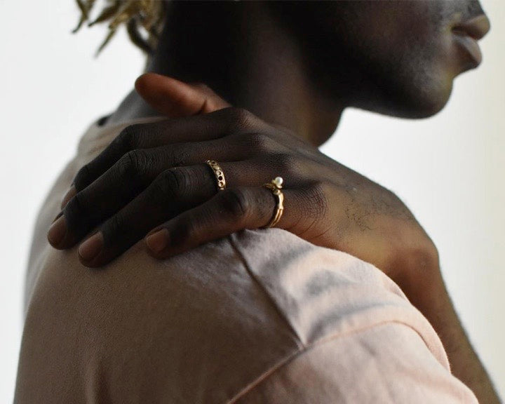 Passage to Peace 14k gold ring and Nana's ring shown on male model.
