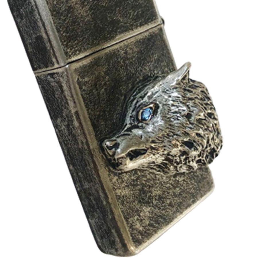 Trust your instincts, this incredibly amazing wolf lighter will make setting flames your favorite conversation piece. Fine silver with blue sapphire eye.