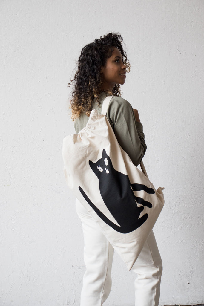 Grace Estrada Black Cat Duffle or Tote Bag shown on person holding it with sturdy strap