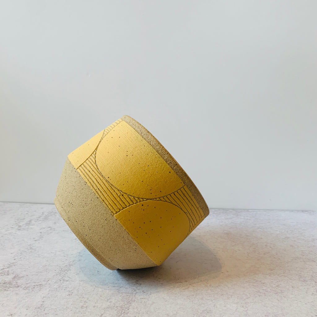 Judith's wheel thrown planters create mix and match delight with their geometric designs and fresh style. Yellow. Dots.