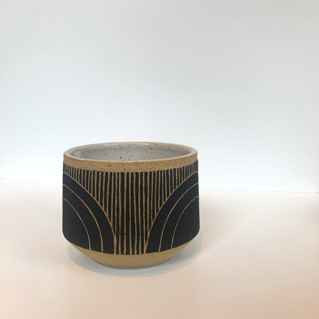 Judith's wheel thrown planters create mix and match delight with their geometric designs and fresh style. Black color way. Rainbow. Side view.