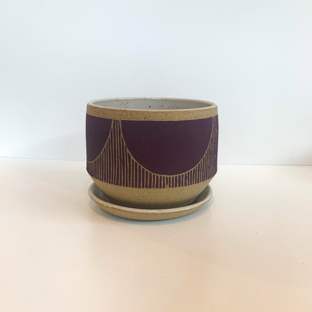 Judith's wheel thrown planters create mix and match delight with their geometric designs and fresh style. Purple. Bridge.