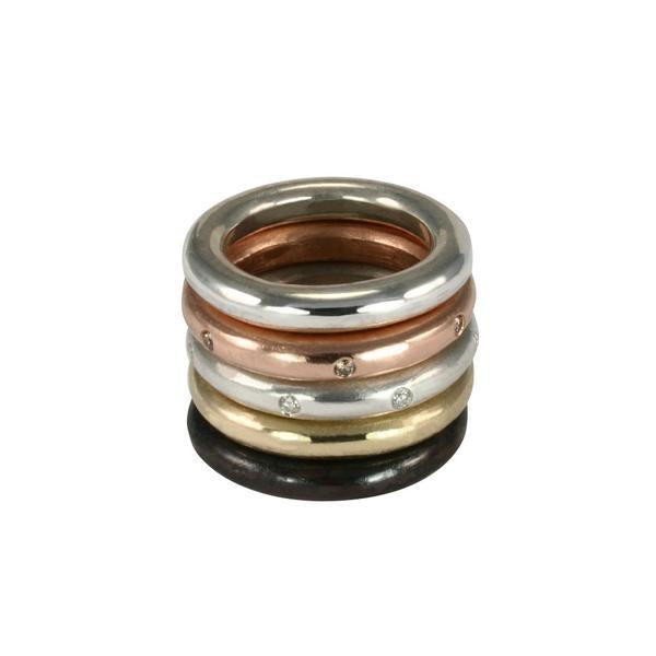 Jeffrey Levin thick round stacking rings in 14k yellow gold, rose gold, white gold and silver.