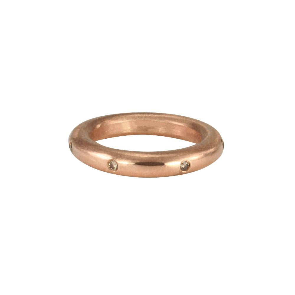 Stunning layered or alone–goes with everything, thick round stacking rings. Mixed metals available in sterling silver; 14k yellow, white or rose gold; or platinum. Take your stack to another level, embellished with diamonds and gems. Rose gold with cognac diamonds shown.