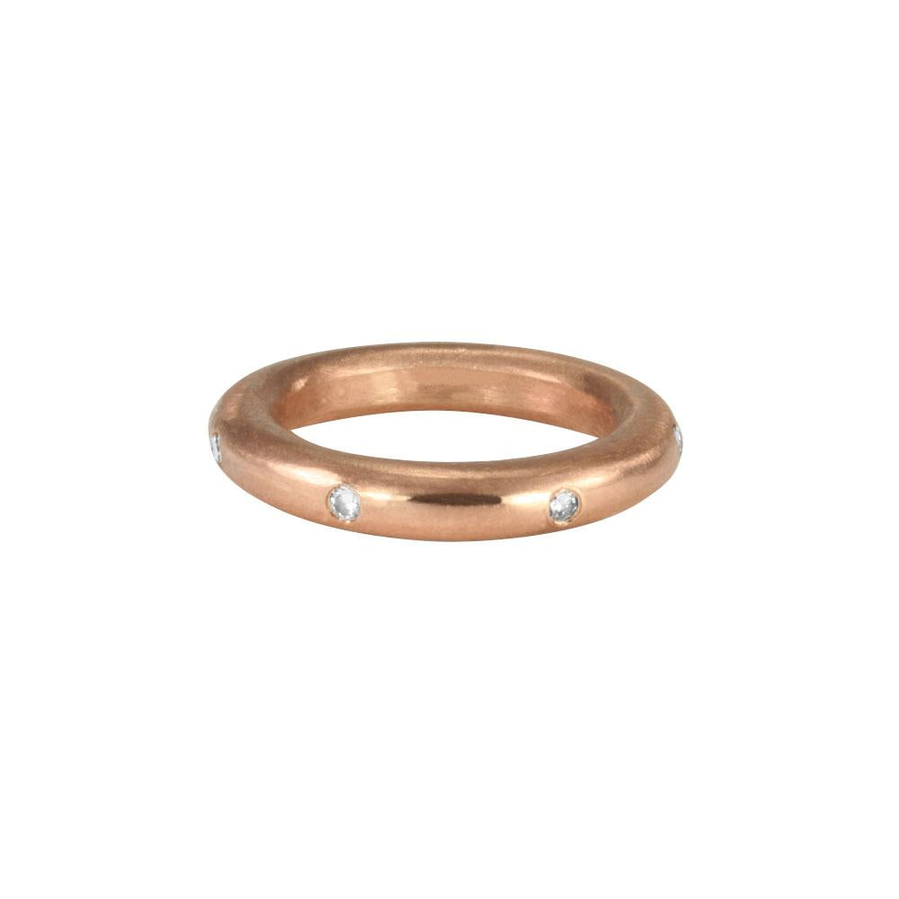 Stunning layered or alone–goes with everything, thick round stacking rings. Mixed metals available in sterling silver; 14k yellow, white or rose gold; or platinum. Take your stack to another level, embellished with diamonds and gems. 14k rose gold shown with white diamonds.