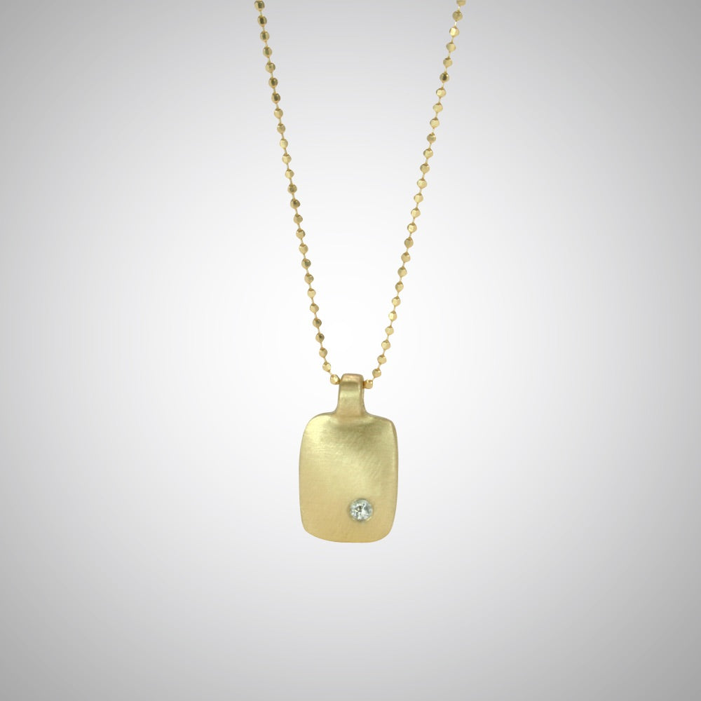 Jeffrey reimagined the classic dog tag into a modern canvas, both refined and a bit edgy. This is a classic version in 14 gold with a single diamond.