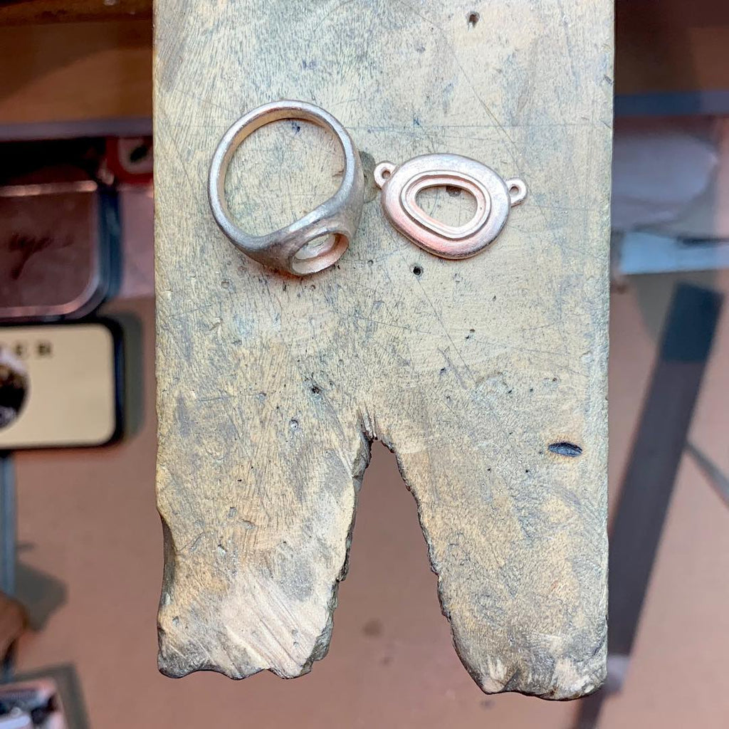 Process of castings getting ready for setting for bespoke pendants and rings with tourmaline and opals. By Jeffrey Levin.