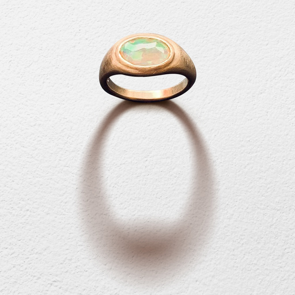 Poet and/the Bench goldsmith and co-founder Jeffrey Levin captured the beauty of this unique stone, hand-carving a yellow gold setting designed to bring the opal's best features to life.