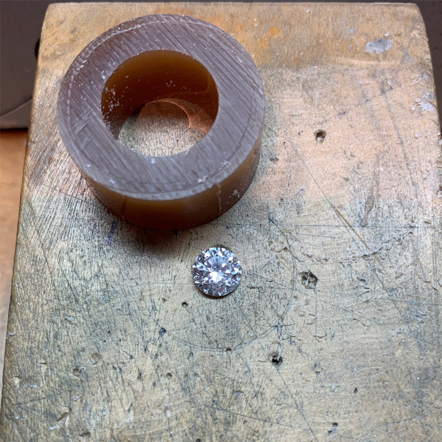 Custom Engagement Ring Process. Carving wax to create the setting and feature the diamond. We source diamonds and gems and we're also happy to work with an heirloom stone you have in your family.